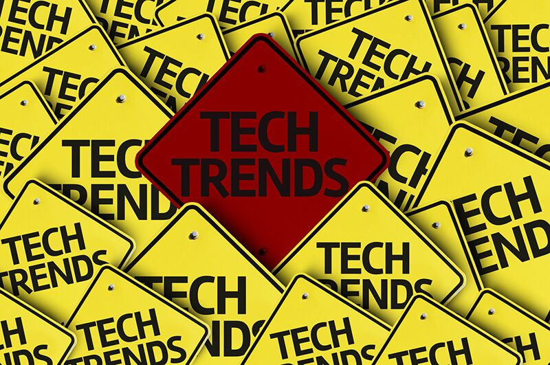"yellow signs that read ""tech trends"""